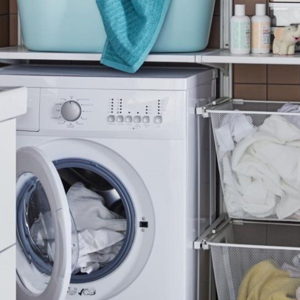 A white washing machine being repaired in Richmond BC by Top Appliance Repair Richmond.
